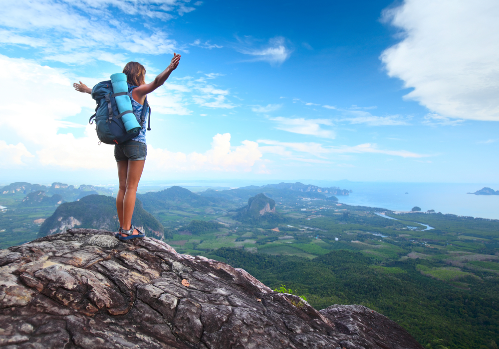 Woman-on-mountain-top